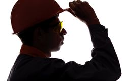 Silhouette profile of a man face construction engineer in helmet Stock Photos