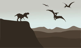 Silhouette of pterodactyl and tyrannosaurus. In cliff Royalty Free Stock Photo