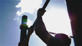Silhouette of the pulling up man outdoors. The sun glare stock video footage