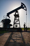 Silhouette Pump Jack Stock Photo