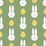 Silhouette of a rabbit`s head and painted eggs. Easter seamless pattern. Stock Photo