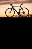 Silhouette of race bike in sunset Stock Photography