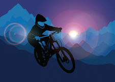 Silhouette of a racer descending on a bicycle on a mountainside against the background of the evening sun. Vector Royalty Free Stock Image