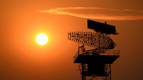 Silhouette radar communication tower and plane stock video footage