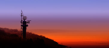 Silhouette of a radar station on the Polish coast at sunset. Royalty Free Stock Photography