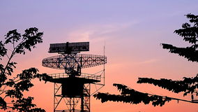 Silhouette radar tower communication and plane stock video