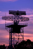 Silhouette radar tower plane and twilight sky Royalty Free Stock Photos