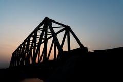 Silhouette. The railway bridge over the  river Stock Photo
