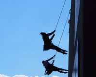 Silhouette Of Rappelling Dancers Royalty Free Stock Image