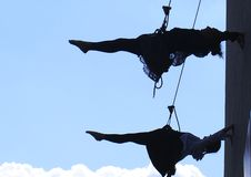 Silhouette Of Rappelling Dancers Stock Images