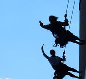 Silhouette Of Rappelling Dancers Royalty Free Stock Photo