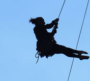 Silhouette Of Rappelling Dancers Stock Photos