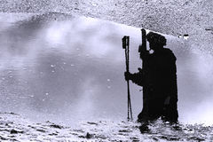 Silhouette of the refection of a skier Stock Photos