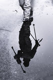 Silhouette of the refection of a skier Royalty Free Stock Image
