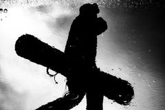 Silhouette of the refection of a snowboarder Stock Photos