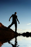 Silhouette reflection. Silhouette of a man reflected on water Royalty Free Stock Images