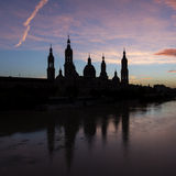 Silhouette and reflection of the basilica of Pilar in Zaragoza. Stock Images