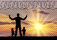 Silhouette refugees father and two children Stock Photos