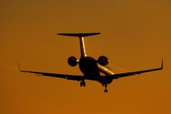Silhouette of regional jet facing sun Stock Photography