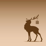 Silhouette of reindeer. Against the brown background Royalty Free Stock Images