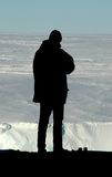 Silhouette of researcher in front of Antarctica Royalty Free Stock Images