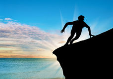 Silhouette resistant person on a rock Royalty Free Stock Photography