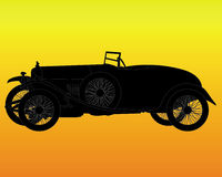 Silhouette of a retro car. Black silhouette of a retro car on an orange background Royalty Free Stock Photos