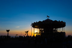 Silhouette of a retro carousel at sunset Stock Photo
