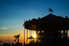 Silhouette of a retro carousel at sunset Stock Images