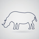 Silhouette of rhino on a light gray background. Under rhino gray. Silhouette of rhino on a light background. Under the icon rhino is light gray shade Royalty Free Stock Images