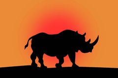 Silhouette of rhino on a red. Sky background royalty free illustration