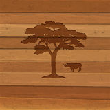 Silhouette of rhino and tree on wooden background Stock Image