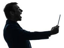 Silhouette riante de comprimé numérique d'homme d'affaires Photographie stock libre de droits