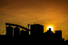 Silhouette rice mill. Silhouette of rice mill with sunset sky stock photos