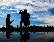 Silhouette of the rich and the poor man on the background cityscape. Social inequality. Silhouette of the rich and the poor man on the background cityscape stock photo