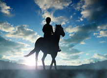 Silhouette rider on horse Stock Images