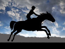 Silhouette of a rider on a running horse Royalty Free Stock Photo