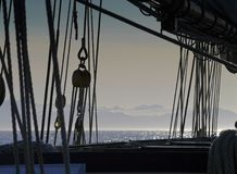 Silhouette of a rigging against foggy sea Stock Photo