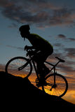 Silhouette road bike uphill Royalty Free Stock Images