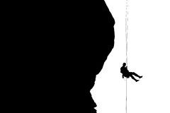 Silhouette of rock climber belaying hoodoo Stock Images