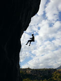 Silhouette of rock climber going down Royalty Free Stock Image