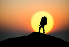 Silhouette of a rock climber. On the peak. Sport and active life concept Stock Photos