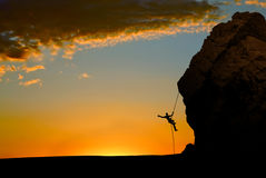 Silhouette of Rock Climber at Sunset Royalty Free Stock Image