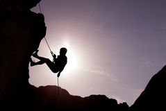 Silhouette of Rock Climber. Silhouette of a climber on a vertical wall over beautiful sunset Stock Image