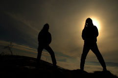 Silhouette of rockers in the darkness Stock Image