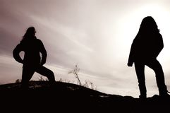 Silhouette of rockers in the darkness Stock Photography