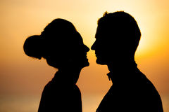 Silhouette of romantic couple on the beach at sunset Stock Photo