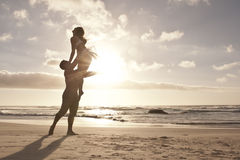 Silhouette of romantic couple dancing on beach Royalty Free Stock Photos