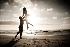 Silhouette of romantic couple dancing on beach Royalty Free Stock Images
