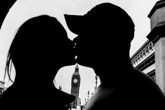 Silhouette of a romantic couple kissing near Big Ben in London stock photo